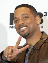 """US actor Will Smith poses as he arrives for a photocall ahead of the German Premiere of """"Men in Black 3"""" in Berlin, Monday, May 14, 2012. (AP Photo/Jens Meyer)"""