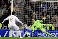 Bayern Munich goalkeeper Manuel Neuer stops a penalty kick from Real Madrid's Kaka during the Champions League second leg semi-final against Bayern Munich at the Santiago Bernabeu stadium on Wednesday