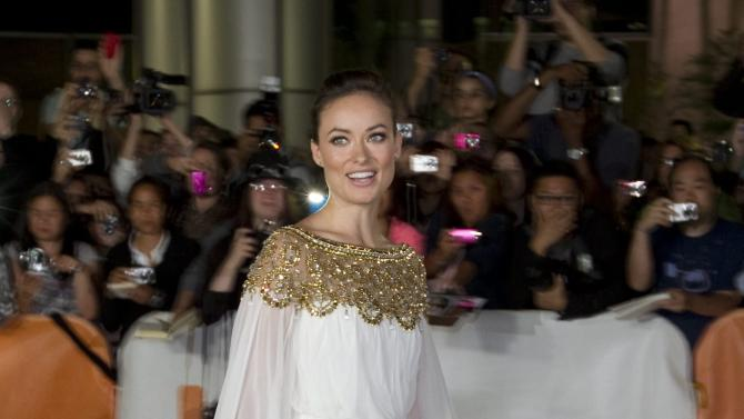 """Actress Olivia Wilde poses at the gala for the film """"Butter"""" during the Toronto International Film Festival in Toronto Tuesday, Sept.  13, 2011.  (AP Photo/The Canadian Press, Darren Calabrese)"""