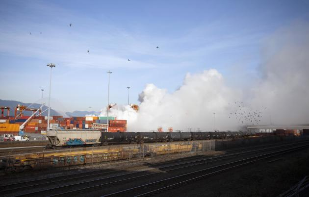 Smoke from a fire rises at the Port Metro Vancouver
