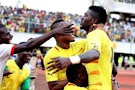 Togo striker Emmanuel Adebayor (right) is congratulated by his teammates after scoring a goal during the Africa Cup of Nations qualifier against Gabon at the Kégué stadium in Lomé. Togo defeated Gabon 2-1 to qualify for the 2013 Africa Cup of Nations