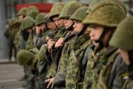 Russian troops cordon off an area around an anti-Putin protest in Moscow. Tens of thousands of Russian opposition supporters thronged the streets of Moscow on Saturday to keep up the momentum of their challenge to Vladimir Putin's rule four months into his new mandate