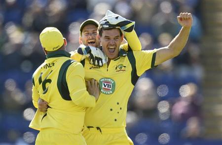 Australia's Clint McKay (R) celebrates with teammates Matthew Wade and Aaron Finch (L) after achieving a hat-trick after dismissing England's Joe Root during the fourth one-day international at Sophia gardens in Cardiff, Wales September 14, 2013. REUTERS/Philip Brown