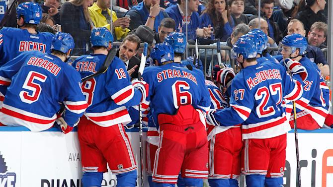 Coach John Tortorella of the New York Rangers gathers his team during a time out in the second period against the Pittsburgh Penguins at Madison Square Garden on January 20, 2013 in New York City. (Photo by Scott Levy/NHLI via Getty Images)