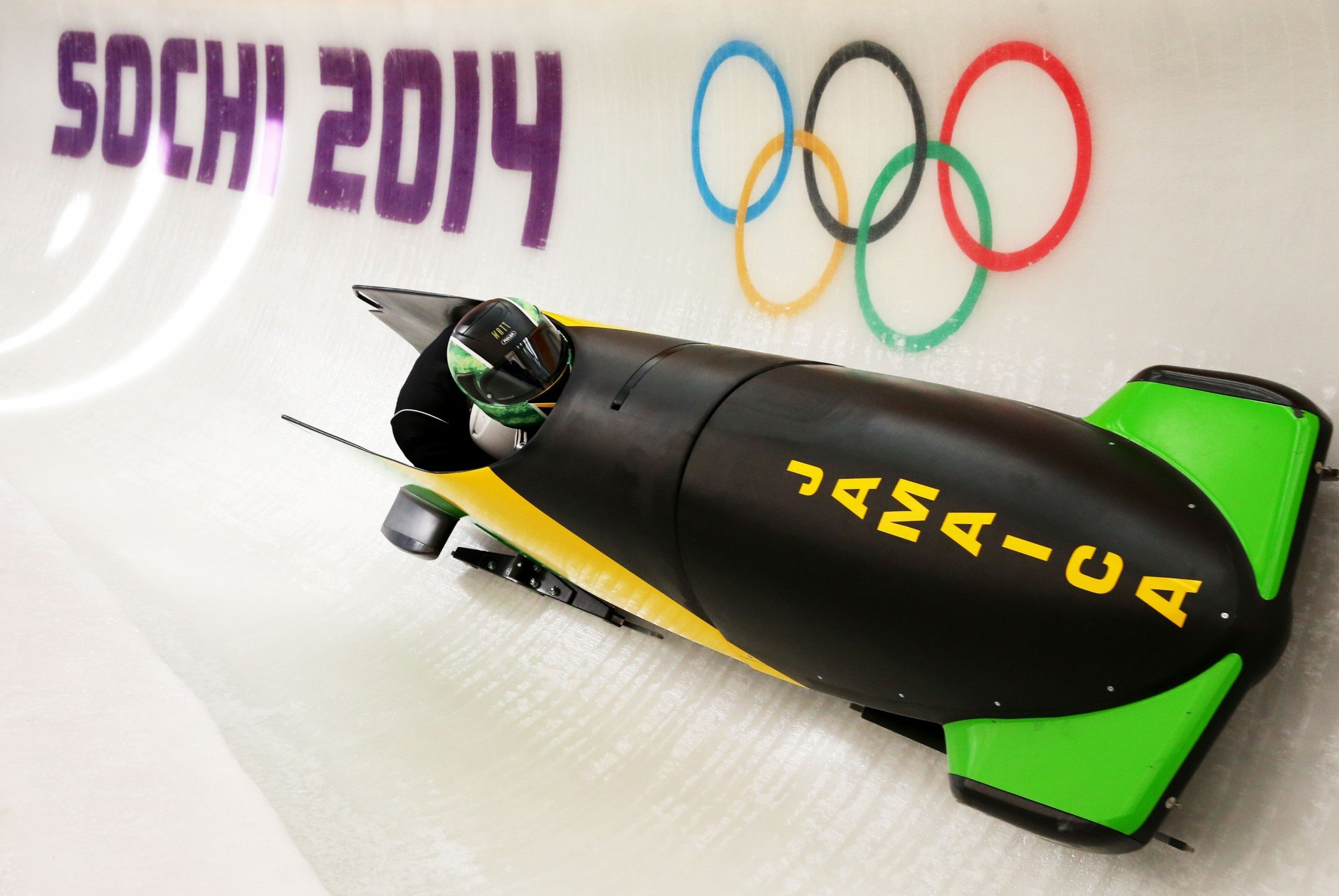Winston Watts of Jamaica pilots a bobsleigh practice run ahead of the Sochi 2014 Winter Olympics at the Sanki Sliding Center. (Photo: Getty Images)