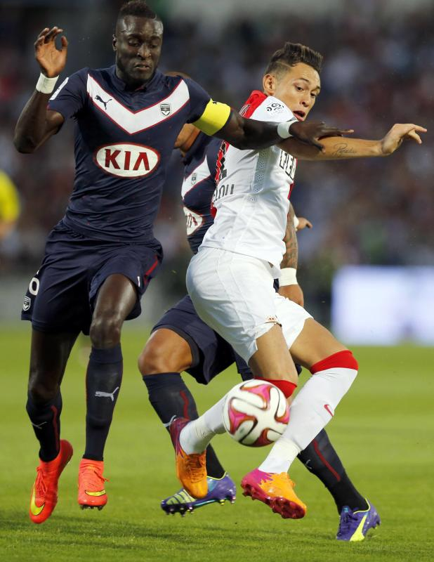 Ludovic Sane of Girondins Bordeaux fights for the ball with Lucas Ariel Ocampos of Monaco during their French Ligue 1 soccer match at the Chaban...