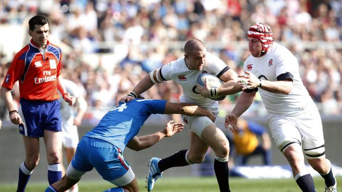 England's Mike Brown runs with the ball flanked by his teammate Ben Morgan as Italy's Angelo Esposito tries to tackle during their Six Nations rugby union match at Olympic Stadium in Rome