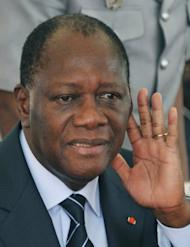 Ivorian President Alassane Ouattara (C) gestures during the official launch of the construction works of a 30 km highway linking Abidjan to Grand Bassam on August 3, 2012. Ouattara has struggled to stabilise a country still awash with weapons and demobbed fighters, more than a year after the end of a deadly post-election crisis