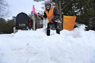Earl Pollock digs out his mailbox after a blizzard, Monday, Feb. 13, 2017, in Freeport, Maine. A fluffy snow up to two-feet deep blanketed parts of the Northeast, just days after the biggest storm of the season dumped up to 19 inches of snow on the region. (AP Photo/Robert F. Bukaty)