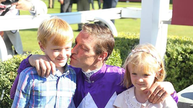 Richard Hughes after his last ever race on Fox Trotter in the 4:55 Qatar Stakes (Handicap) with his children Harvey (L) and Phoebe (R)