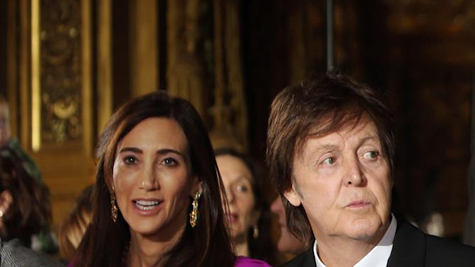 Nancy Shevell and Sir Paul McCartney watch fashion designer Stella McCartney's Fall/Winter 2013-2014 ready to wear collection, in Paris, Monday, March, 4, 2013. (AP Photo/Thibault Camus)