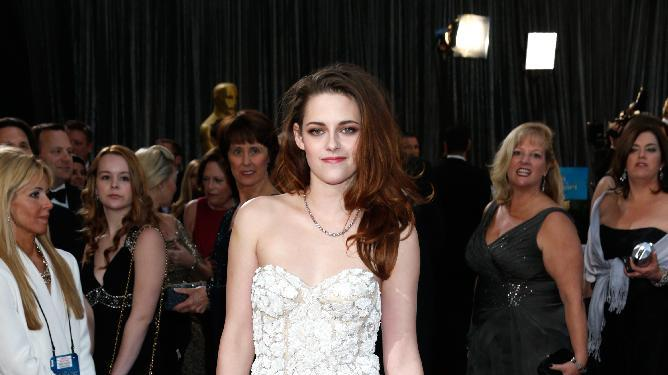 Actress Kristen Stewart arrives at the Oscars at the Dolby Theatre on Sunday Feb. 24, 2013, in Los Angeles. (Photo by Todd Williamson/Invision/AP)