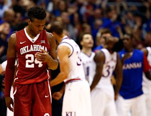 Buddy Hield reacts as Jayhawks celebrate during Oklahoma's loss. (Getty)