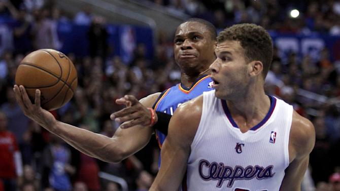 Oklahoma City Thunder guard Russell Westbrook, left, takes a shot with Los Angeles Clippers forward Blake Griffin (32) defending in the second half of their NBA basketball game Wednesday, Nov. 13, 2013, in Los Angeles. The Clippers won the game 111-103