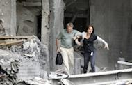 A man helps a wounded woman evacuating a building after an explosion near government buildings in Norway's capital Oslo on July 22, 2011. Anders Behring Breivik, who is set to go on trial on April 16 for killing 77 people in Norway last July -- including eight in the blast -- said in a letter published Wednesday that being sentenced to psychiatric care would be the worst fate imaginable