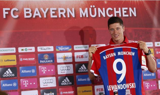 New Bayern Munich soccer player, Polish striker Robert Lewandowski, presents his new jersey during a news conference at Bayern Munich's headquarters