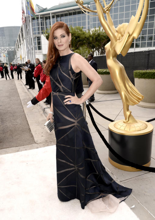 Debra Messing arrives at the 66th Primetime Emmy Awards at the Nokia Theatre L.A. Live on Monday, Aug. 25, 2014, in Los Angeles. (Photo by Dan Steinberg/Invision for the Television Academy/AP Images)