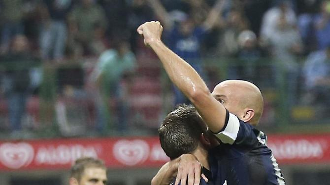 Inter Milan Argentine midfielder Esteban Cambiasso, top right, celebrates with his teammate defender Hugo Campagnaro, of Argentina, after winning the Serie A soccer match between Inter Milan and Fiorentina at the San Siro stadium in Milan, Italy, Thursday, Sept. 26, 2013