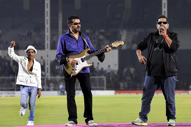 Indian Bollywood musicians and singers Shankar Mahadevan (R) and Ehsaan Noorani (C) perform during the grand opening ceremony of the Toyota University Cricket Championship (TUCC) first match of the se
