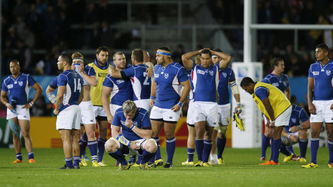 Namibia's Renaldo Bothma (bottom) and team mates look dejected at the end of the match