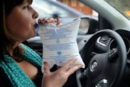 A woman uses a breathalyser (Ethylotest) in the French western city of Quimper. All vehicles travelling on French roads must carry a chemical or electronic breathalyzer test beginning Sunday, under new rules aimed at reducing alcohol-driven accidents