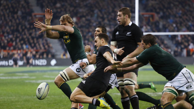Dagg of New Zealand's All Blacks clears the ball as Bekker of South Africa's Springboks attempts to smother during their Rugby Championship test match in Dunedin