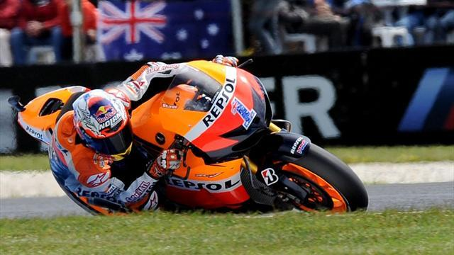 Motorcycling - Stoner storms to Australian MotoGP pole