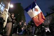 A woman holds a French flag during a protest organized by fundamentalist Christians group Civitas Institute against same-sex marriage on January 29, 2013 in Paris. France's prime minister on Tuesday predicted that gay marriage will quickly be accepted by a country that has spent months embroiled in rancorous debate