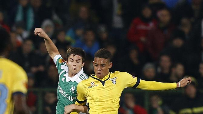 Perea of Lazio is challenged by Mantyla of Ludogorets during their Europa League soccer match in Sofia