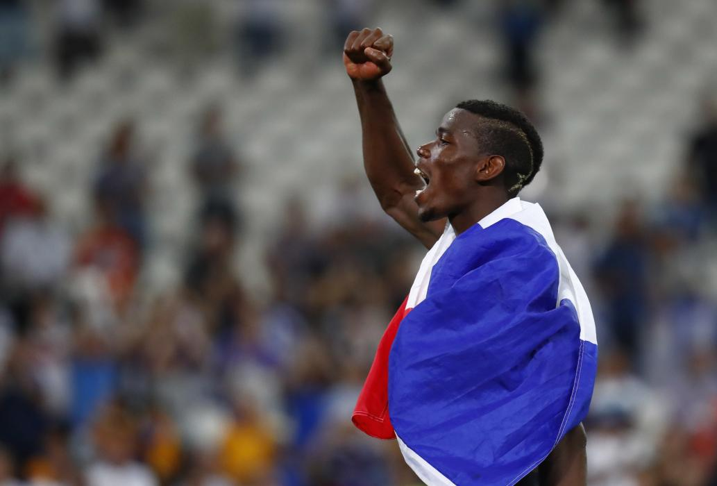 France's Paul Pogba celebrates at the end of the match