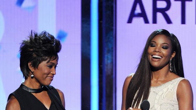 Angela Bassett, left, and Gabrielle Union speak on stage at the BET Awards at the Nokia Theatre on Sunday, June 30, 2013, in Los Angeles. (Photo by Frank Micelotta/Invision/AP)