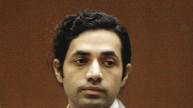 FILE- In this Nov. 13, 2008 file photo, fashion designer Anand Jon Alexander appears at his sexual assault trial in Los Angeles. Alexander, already serving 59 years to life in California for molesting would-be models, was sentenced in New York on Tuesday April 2, 2013, to five years in a similar case in a courtroom full of his supporters who blew him kisses. (AP Photo/Nick Ut, File)