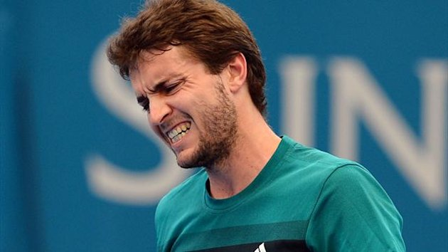 Gilles Simon of France reacts after missing a shot against Marcos Baghdatis of Cyprus in their quarter-final match at the Brisbane International (AFP)