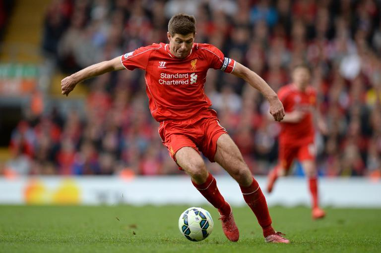 Liverpool's English midfielder Steven Gerrard runs with the ball during the English Premier League football match in Liverpool, England, on May 16, 2015