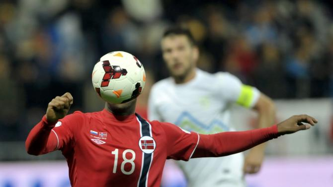 Norway's Kamara controlls the ball in front of Slovenia's Cesar during their World Cup 2014 qualifier soccer match in Maribor