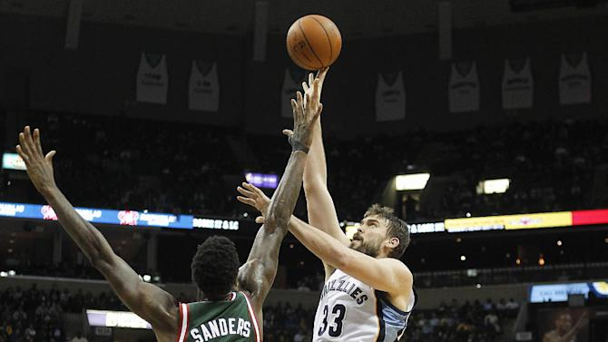 Memphis Grizzlies center Marc Gasol (33), of Spain, shoots against Milwaukee Bucks center Larry Sanders (8) and forward Caron Butler (3) in the second half of an NBA basketball game on Saturday, Feb. 1, 2014, in Memphis, Tenn. The Grizzlies won 99-90