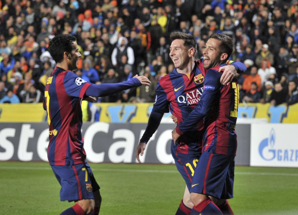 Barcelona's Lionel Messi celebrates with team mates after scoring a goal during their Champions League Group F soccer match against APOEL Nicosia ...