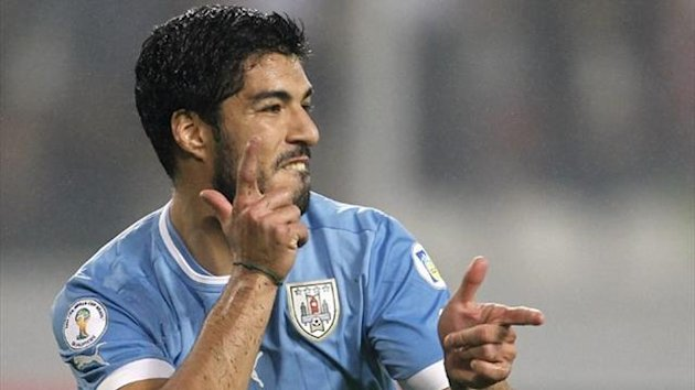 Uruguay's Luis Suarez celebrates after scoring against Peru (Reuters)
