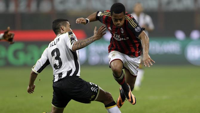 AC Milan's Robinho gets the ball past Udinese defender Allan Loureiro Marquez of Brazil, during a Serie A soccer match between AC Milan and Udinese, at the San Siro stadium in Milan, Italy, Saturday, Oct. 19, 2013