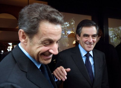 Former French president Nicolas Sarkozy (L) and ex-prime minister Francois Fillon leave a restaurant in October 2012. Sarkozy on Monday waded in to a bitter leadership battle that has left France's main right-wing opposition party, the UMP, on the verge of collapse.