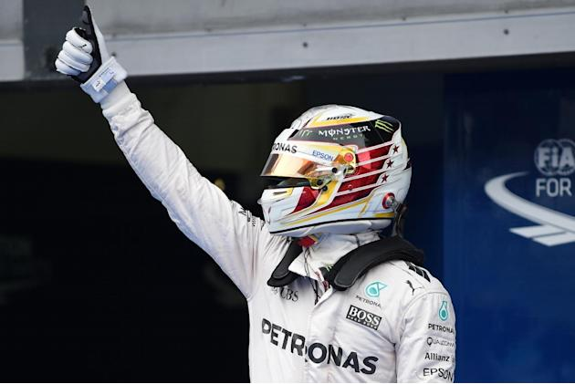 Formula One - Hamilton scorches to record Malaysia GP pole