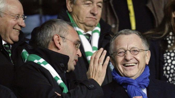 Olympique Lyon's chairman Aulas smiles with St Etienne's supporters before their French Ligue 1 soccer match at the Geoffroy Guichard stadium