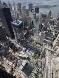 The skyscraper called Four World Trade Center, center, is rising above the September 11 Memorial and Museum, bottom center, Wednesday, Aug. 24, 2011 in New York. Developer Larry Silverstein is constructing Four WTC and two additional towers at the site. (AP Photo/Mark Lennihan)