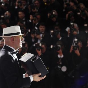 Director Jacques Audiard holds the Palme d'Or award for the film Dheepan as he poses for photographers during a photo call following the awards ceremony at the 68th international film festival, Cannes, southern France, Sunday, May 24, 2015. (AP Photo/Thibault Camus)
