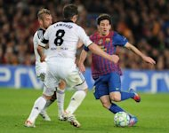 Barcelona forward Lionel Messi (right) vies for the ball with Chelsea midfielders Raul Meireles (left) and Frank Lampard during the UEFA Champions League semi-final at the Cam Nou stadium in Barcelona. Roberto Di Matteo hailed the phenomenal spirit of his players after Chelsea completed the latest in a line of stunning fightbacks to upset Barcelona and advance to the Champions League final