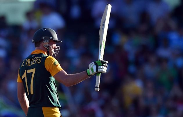 South Africa's AB de Villiers celebrates reaching his 150 against the West Indies at the Sydney Cricket Ground on February 27, 2015