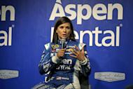 FILE - In this Sept. 18, 2015, file photo, Danica Patrick talks to media at a news conference before her practice for the NASCAR Sprint Cup Series auto race at Chicagoland Speedway, in Joliet, Ill. One of Patrick's sponsors has stepped up to fill a sudden funding void created when Stewart-Haas Racing sued her primary backer for $31 million in a breach of contract suit. Aspen Dental said Tuesday, Feb. 14, 2017, it will be the lead sponsor for Patrick and debut on her car in the Feb. 26 season-opening Daytona 500. (AP Photo/Nam Y. Huh, File)