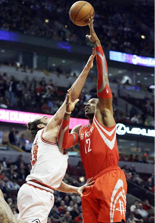 Houston Rockets forward Dwight Howard, right, shoots over Chicago Bulls center Joakim Noah during the first half of an NBA basketball game in Chicago on Thursday, March 13, 2014