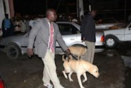Kenyan police officers arrive with sniffer dogs late on May 15, 2012 at the scene of a grenade attack in the coastal city of Mombasa in which one person was killed when it was thrown at a crowded restaurant. Kenya police have arrested a man suspected to have taken part in the grenade attack, police chief Mathew Iteere said Wednesday