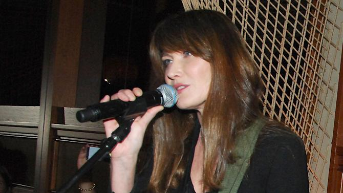 In this June 26, 2013 photo released by Patrick McMullan.com, French singer Carla Bruni performs at the Royalton Hotel in New York. (AP Photo/Patrick McMullan.com, Owen Hoffmann)